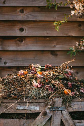 A small compost heap in a garden.